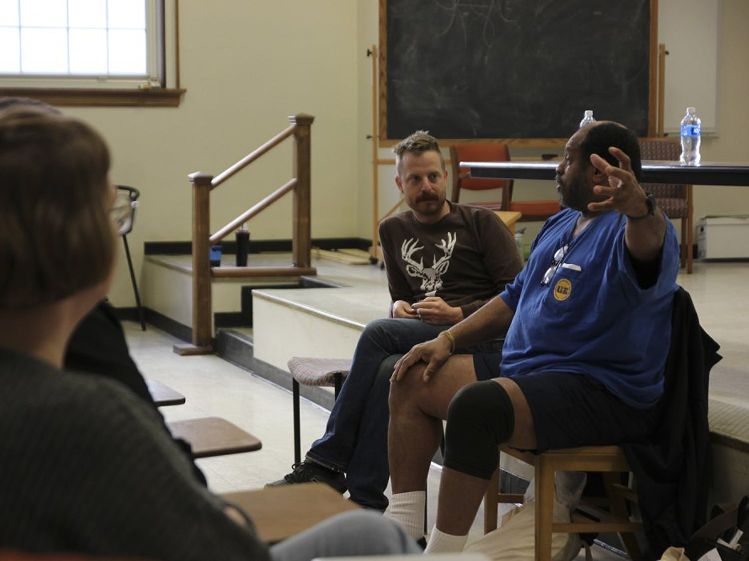 Mike Dimpfl (left) and Angaza Laughinghouse speak on a panel about workers rights at UNC.