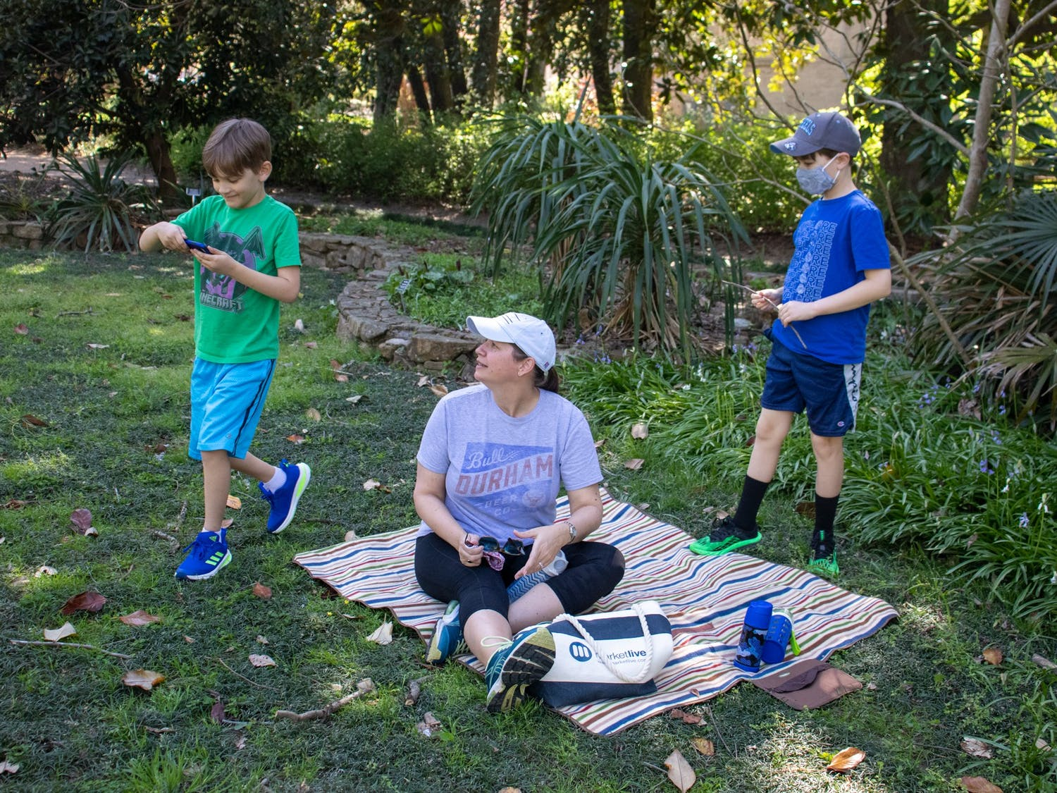 A family plays in Coker Arboretum in Chapel Hill on April 5, 2021.