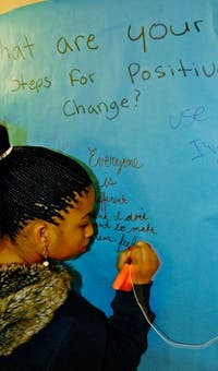 Sophomore Daisa Robinson reflects on the impact of the Tunnel of Oppression in Cobb Residence Hall. DTH/ /Helen Woolard