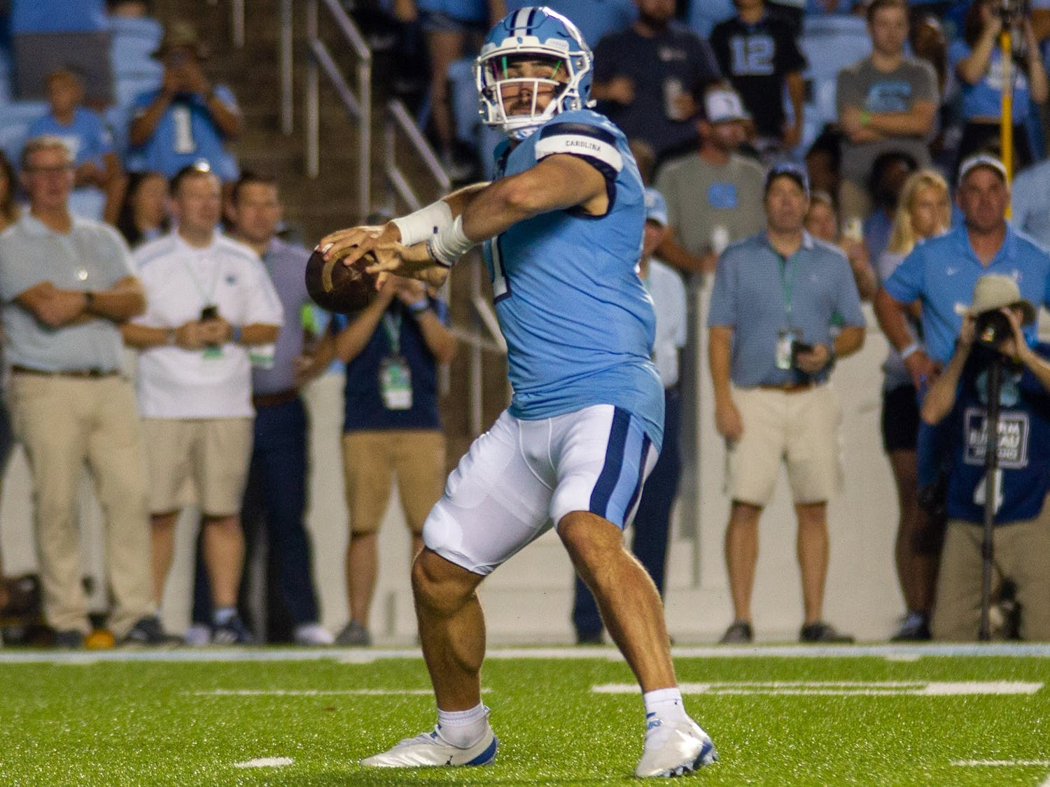 UNC junior quarterback Sam Howell (7) prepares to launch the ball during the Tar Heels' home football matchup in Kenan Memorial Stadium on Sept. 18, 2021, against the University of Virginia Cavaliers. The Tar Heels won 59-39.