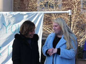 Senior Caroline Bass talks to Chancellor Carol Folt on the steps of South Building on Wednesday, Jan. 30, 2019. Bass organized the goodbye event to thank Folt during her final days at the university.