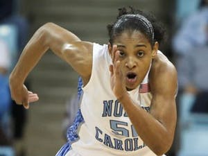 UNC guard Italee Lucas attempts to track down a loose ball in the Tar Heels' 83-73 loss to Florida State. DTH/Phong Dinh