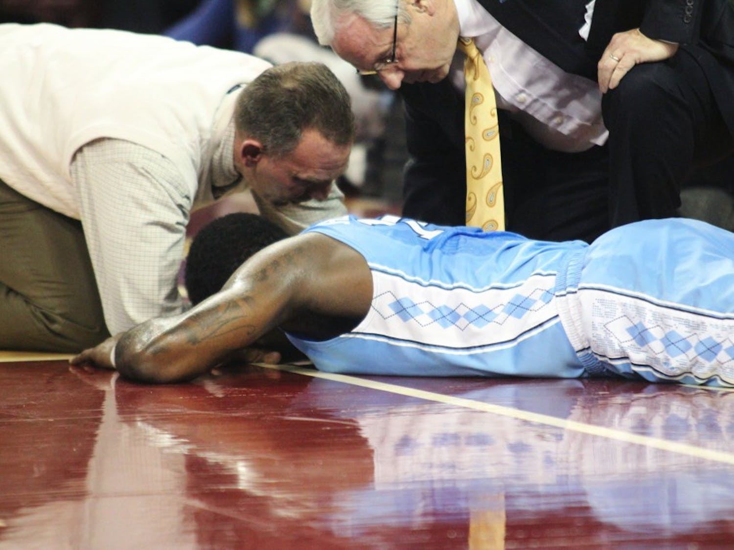 Hairston lies on the court after his collision with Dexter Strickland and Boston College's Patrick Heckmann.