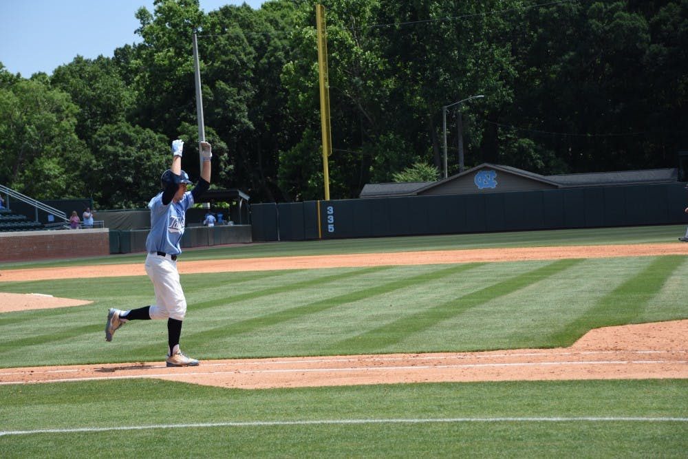 <p>Center fielder Brian Miller celebrates during North Carolina's 8-1 win over Michigan in Chapel Hill Regional play on June 3.</p>
