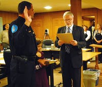 Duane Hampton is sworn in as the new Chief of Police in Hillsborough by Mayor Tom Stevens on Monday at the Hillsborough Town Barn.
