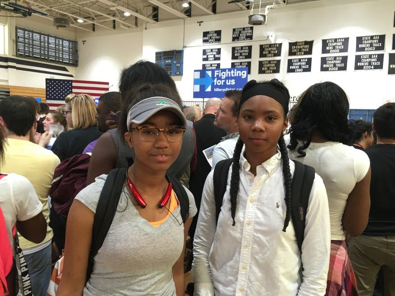 Hillside students Eaneisha Blake and Jada Morgan await Clinton's speech in the gym.