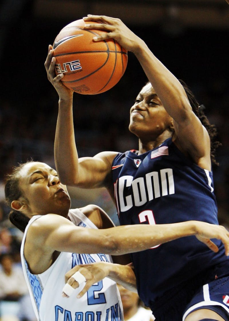 Connecticut guard Tiffany Hayes (3) gets fouled by North Carolina guard Latifah Coleman (2), as she scores two of her 29 points in the second half of play. Connecticut beat the Tar Heels, 83-57, at Carmichael Arena in Chapel Hill, North Carolina, Monday, January 17, 2011. (Chuck Liddy/Raleigh News & Observer/MCT)