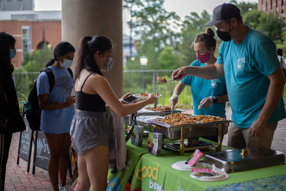 Students line up for food at the Harvest Moon Festival outside of Genome Science Building on Sept. 22.
