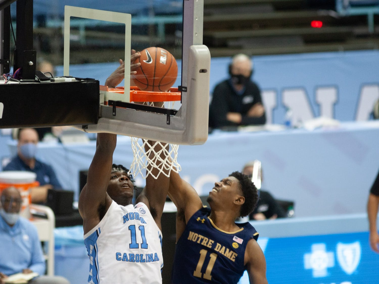 UNC first year forward Day'Ron Sharpe (11) flushes home a go-ahead dunk late in Carolina's 66-65 win over Notre Dame at the Dean E. Smith Center on Saturday, Jan. 2, 2021.