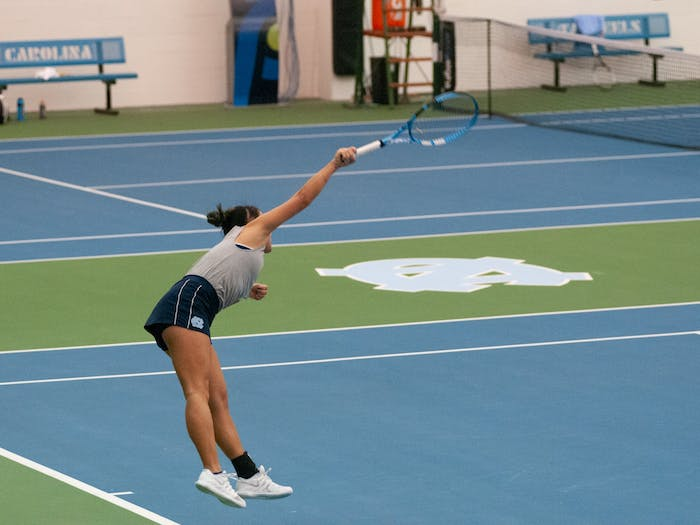 UNC first-year Kacie Harvey serves against her ECU opponent. UNC won against ECU on Saturday, Feb. 15, 2019 in the Cone-Kenfield Tennis Center. The UNC Women's Tennis Team is the 2020 ITA Champion and remain undefeated this season.