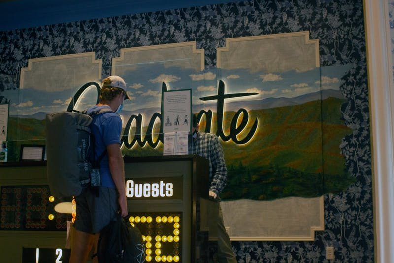 Damien Stahl, 20, checks out of the Graduate Hotel on Thursday, Sept. 17th.