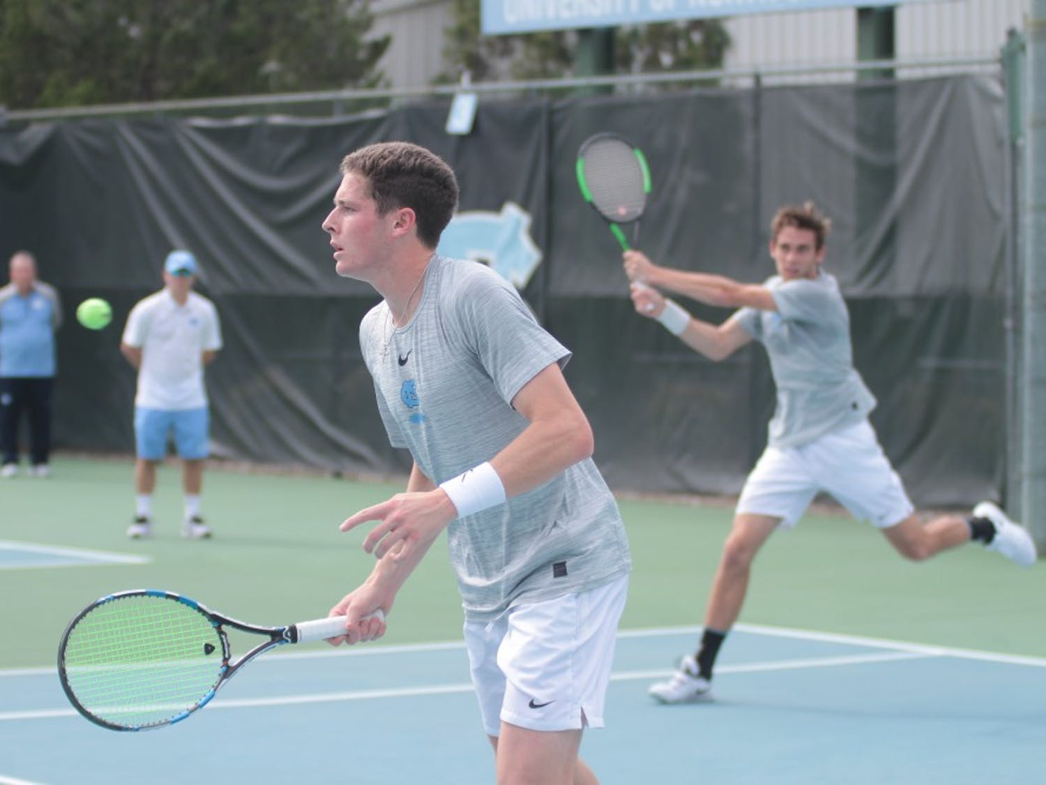 Junior Blaine Boyden (front) and first-year Benjamin Sigouin (back) compete in doubles against Wake Forest on March 28 at the Cone-Kenfield Tennis Center.