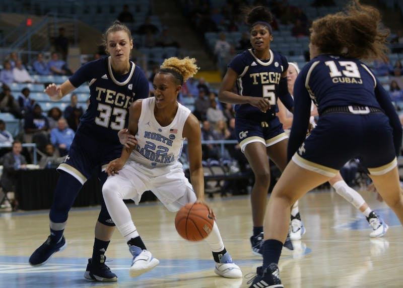 UNC senior guard Paris Kea (22) weaves between Georgia Tech players during a game in Carmichael Arena on Thursday, Jan. 31, 2019. UNC won 91-90.