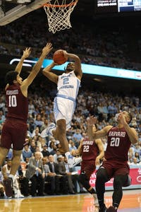 UNC guard Coby White (2) goes for a layup against Harvard in the Smith Center Wednesday, Dec. 2, 2019. UNC defeated Harvard 77-57.