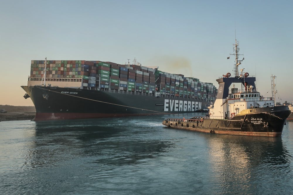 A tugboat drags the Panama-flagged ship, Ever Given, in the Suez Canal after the ship was successfully freed and refloated on Monday, March 29, 2021. Photo courtesy of Handout/DPA/Zuma Press/TNS