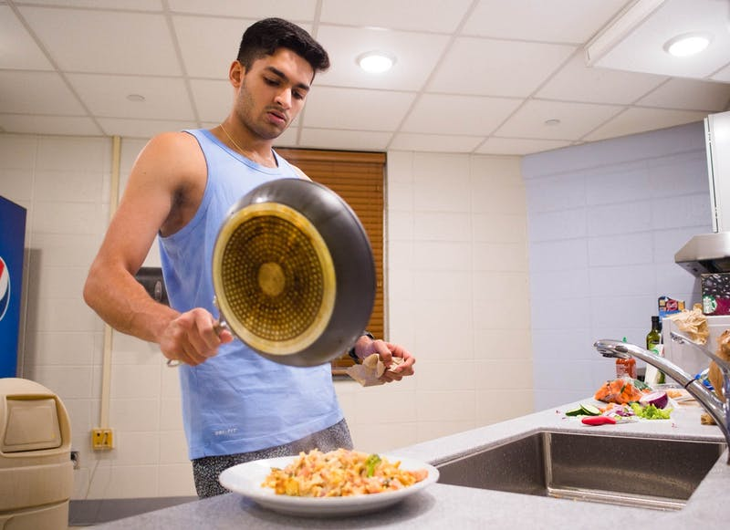 UNC sophomore Vishan Balyan plates his dinner in Hinton James Residence Hall on Monday, Oct. 26, 2020.