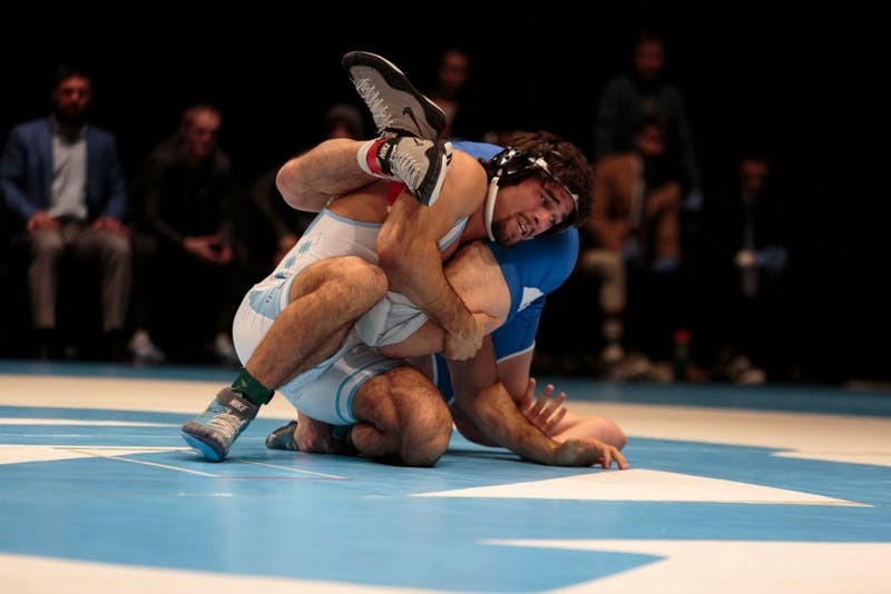 Redshirt senior Ethan Ramos wrestles against Duke on Feb. 15 in Memorial Hall.