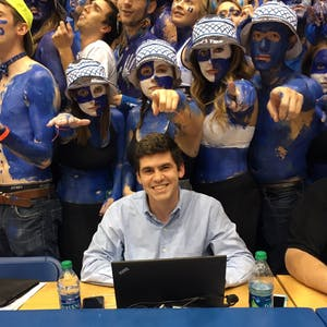 Daily Tar Heel alum Brendan Marks sits at his spot in press row in front of the Cameron Crazies in Cameron Indoor Stadium.