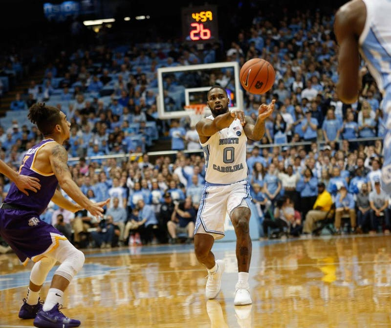 Junior guard Seventh Woods (0) passes the ball to freshman guard Leaky Black (1) in the Dean Smith Center on Friday, Nov. 16, 2018. UNC beat Tennessee Tech 108-58.