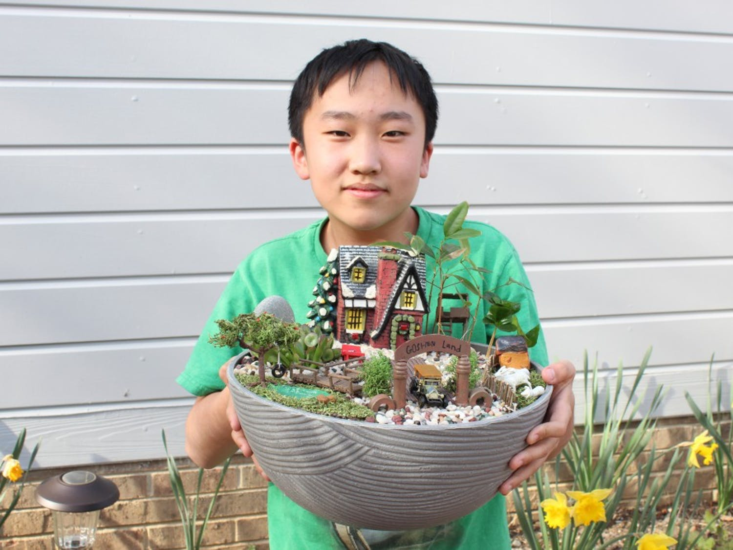 """Chapel Hill student Alex Shen holds his miniature garden """"GoShen Land"""" that he created for the Community in Bloom contest. This contest encourages the community to get creative and find """"trash and treasures""""  around their house to create their own miniature garden. This year's theme is """"Planting a Dream"""" and the deadline to submit your entry is April 25. March 28, 2019. Chapel Hill."""