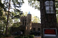 Gimghoul Castle is the headquarters of the Order of Gimghoul, a secret collegiate society in Chapel Hill.  Signs posted outside of the castle warn people to stay off of the property on Tuesday, Oct. 23, 2018.