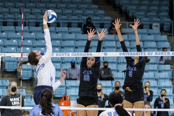UNC sophomore outside hitter Parker Austin (23) spikes the ball in Carmichael Arena on Oct. 9, 2020. The Tar Heels beat the Blue Devils 3-1.