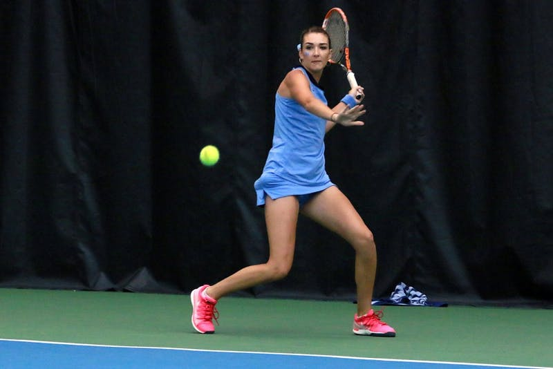 Carolina Price, the only senior on the women's tennis team, returns the ball. Price defeated Samantha Harris during the singles competition.
