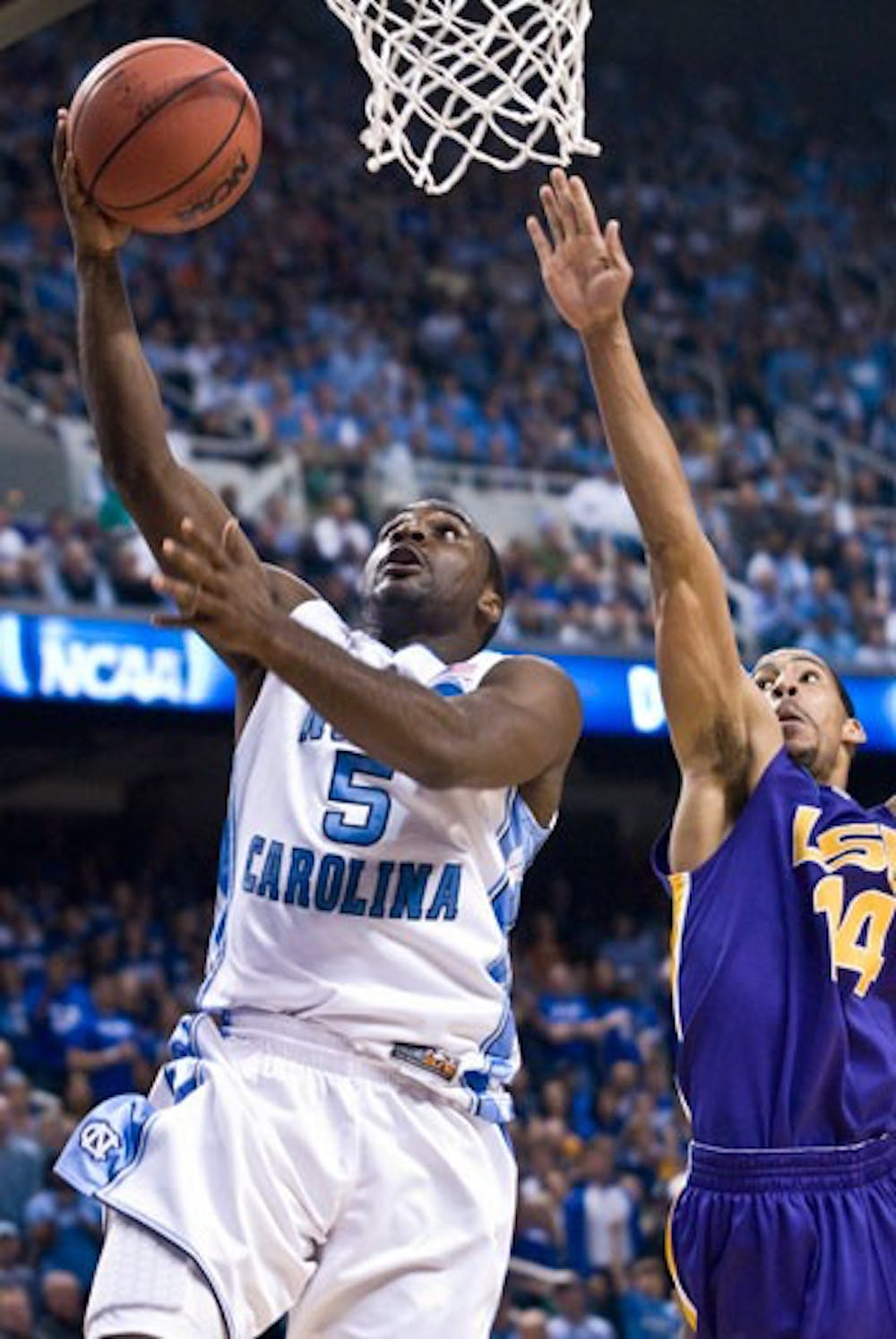 "North Carolina junior Ty Lawson returned from a toe injury to start UNC?s Saturday matchup with LSU. Though Lawson struggled in the first half"" recording only two points he caught fire in the second period and led a 17-2 UNC run that sealed the victory for the Tar Heels."