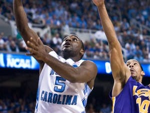"""North Carolina junior Ty Lawson returned from a toe injury to start UNC?s Saturday matchup with LSU. Though Lawson struggled in the first half"""" recording only two points he caught fire in the second period and led a 17-2 UNC run that sealed the victory for the Tar Heels."""