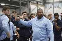 Harlis Meaders, UNC's track and field head coach, addresses the team after a January meet.