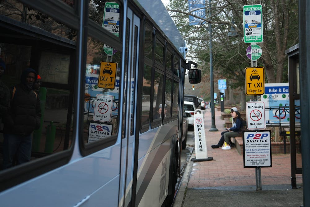 <p>A Chapel Hill Transit bus stops outside Carolina Coffee Shop on Franklin Street on Feb. 7, 2020. The Civic Engagement Action Coalition of Transportation will launch a voting shuttle that will take students directly from South Campus to the early voting site on Feb. 27 and Feb. 28, 2020. The voting shuttle will run non-stop from 10 a.m to 6 p.m.</p>
