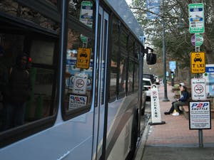 A Chapel Hill Transit bus stops outside Carolina Coffee Shop on Franklin Street on Feb. 7, 2020. The Civic Engagement Action Coalition of Transportation will launch a voting shuttle that will take students directly from South Campus to the early voting site on Feb. 27 and Feb. 28, 2020. The voting shuttle will run non-stop from 10 a.m to 6 p.m.
