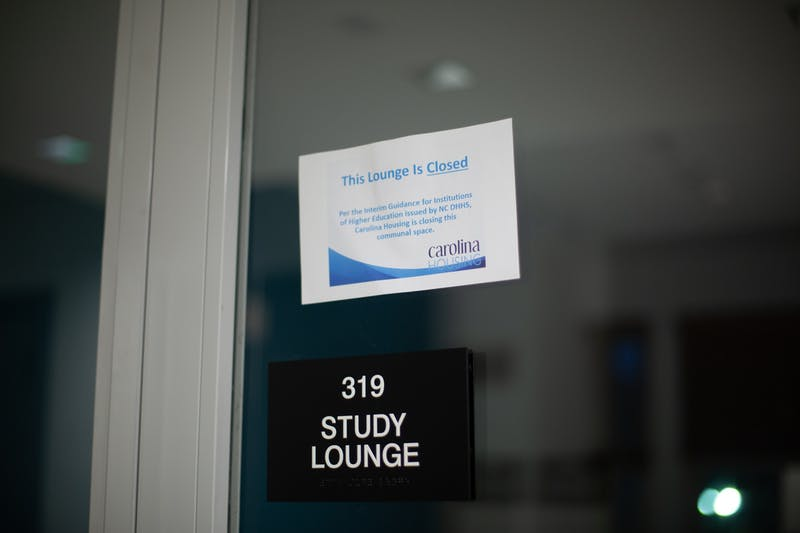 A sign notifies students in Joyner Residence Hall that their study lounge is closed on Sunday, Oct. 25, 2020..