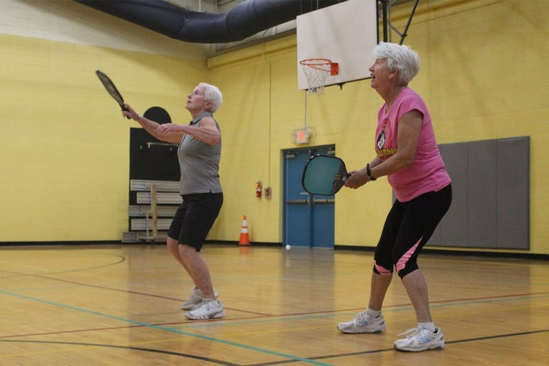 B.J. Atwood and Sandy Iuly play pickle ball at the Chapel Hill Community Center on Friday.