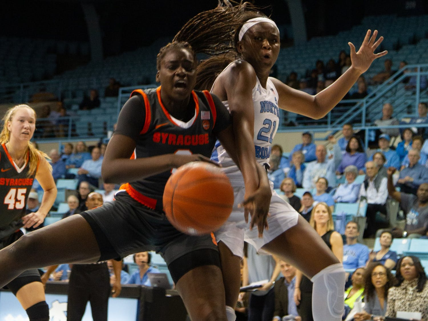 UNC freshmen forward Malu Tshitenge (21) attempts to re bound with Syracuse Maeva Djaldi-Tabdi (3) during a game in Carmichael Arena on Thursday, Feb. 13, 2020. The Orange beat the Tar Heels 74-56.