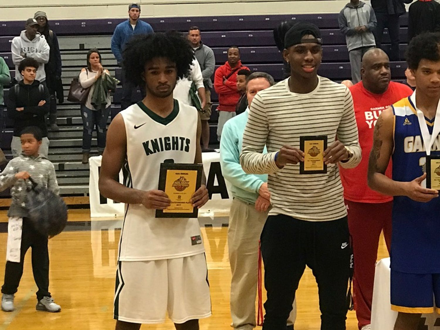 UNC 2018 commit Coby White (left) poses with Greenfield School's runner-up trophy on Dec. 30 at the John Wall Holiday Invitational in Raleigh.