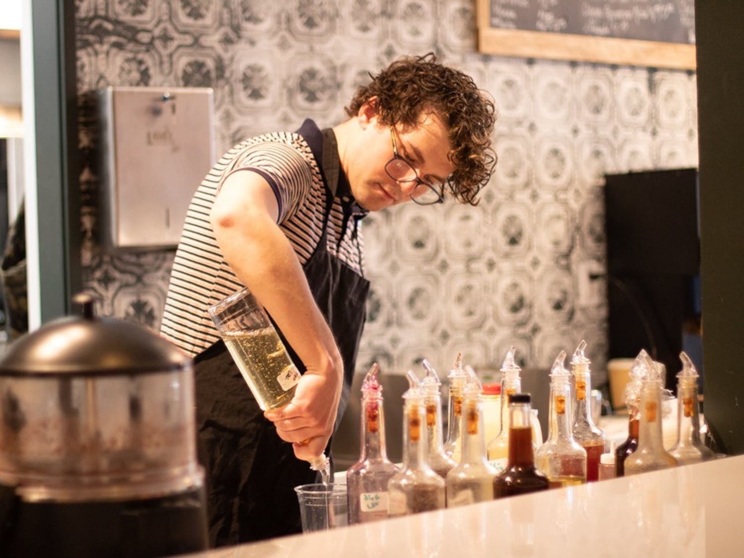 Nick Curee, a 24-year-old Nashville native, prepares a drink at Epilogue Books Chocolate Brews on Dec. 3, 2019.