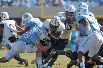 Linebacker Cole Holcomb (36) takes down a hornet during the game against Georgia Tech Saturday, Nov. 3, 2018 at Kenan Memorial Stadium. UNC lost to Georgia Tech 38-28.