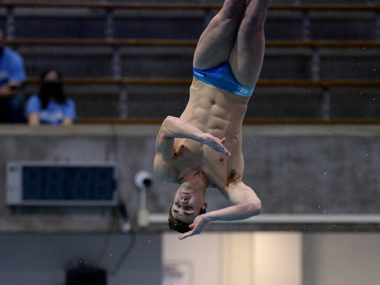 Anton Down-Jenkins dives during a meet against Virginia in Koury Natatorium on Friday, January 22, 2021. Photo courtesy of Jeff Camarati.