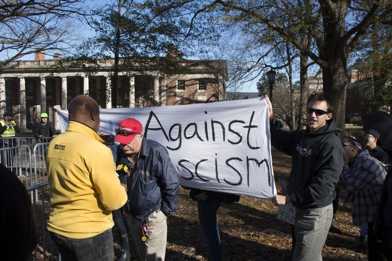 Counter protestors attempt to confound an interview between Lee Stem, a supporter of Silent Sam, and Raleigh television station ABC11 WTVD.