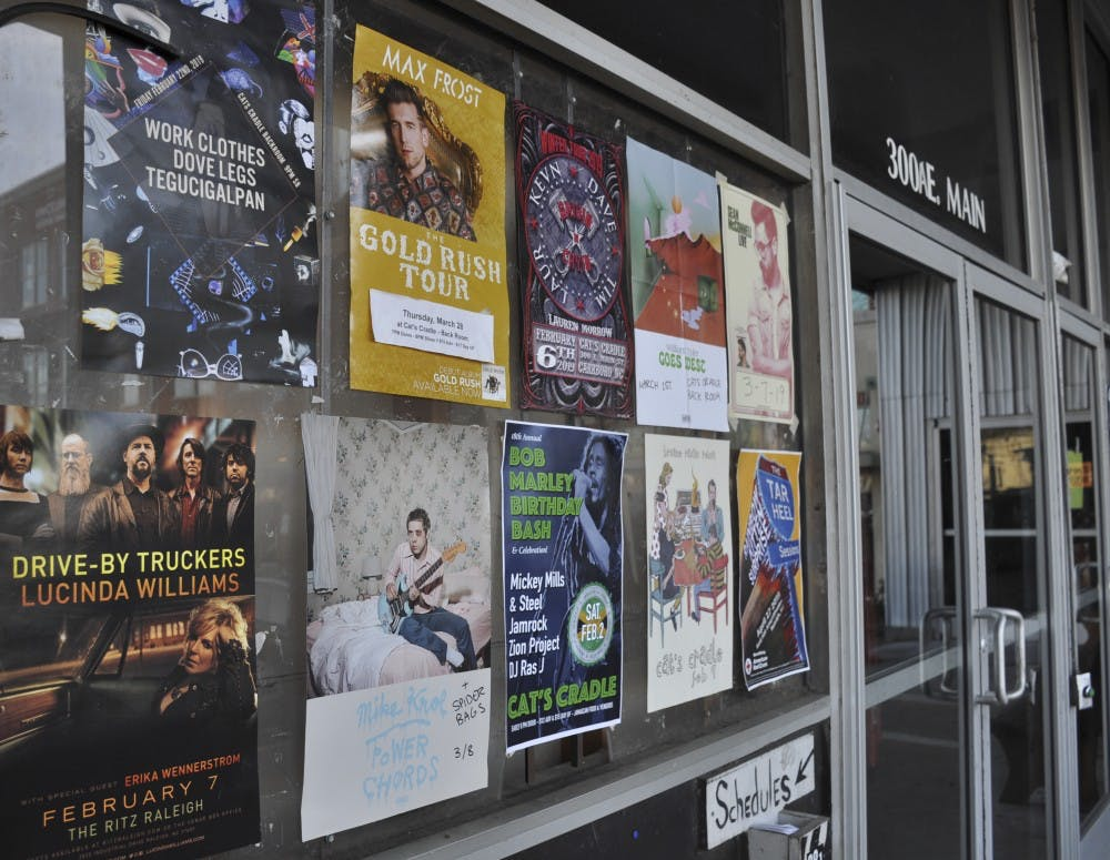 Cat's Cradle hangs posters for upcoming concerts in February and March at their venue in Carrboro on Wednesday, Jan. 30, 2019.