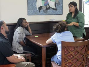 Third year Almas Islas conducts an exercise meant to give students examples of the experiences of undocumented youth Saturday afternoon in the Campus Y.