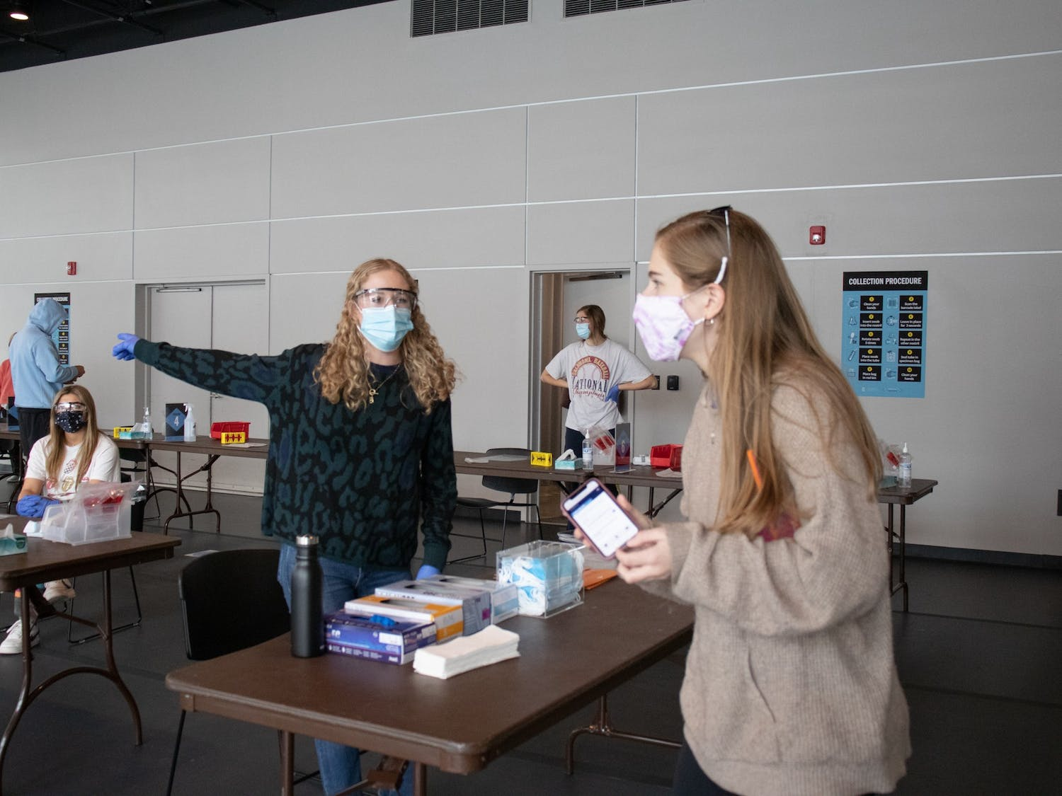 Emily Draper, a senior exercise and sports science major, directs a student at the Current ArtSpace testing site on Friday, Jan. 22, 2021.