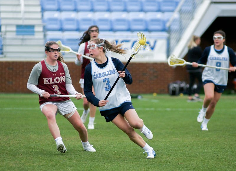 UNC Junior attacker Jamie Ortega (3) scans the field for scoring opportunities and finished the game with six goals. The Tar Heels won 20-3 over Elon during the exhibition match on Feb. 1, 2020, at Dorrance Field.