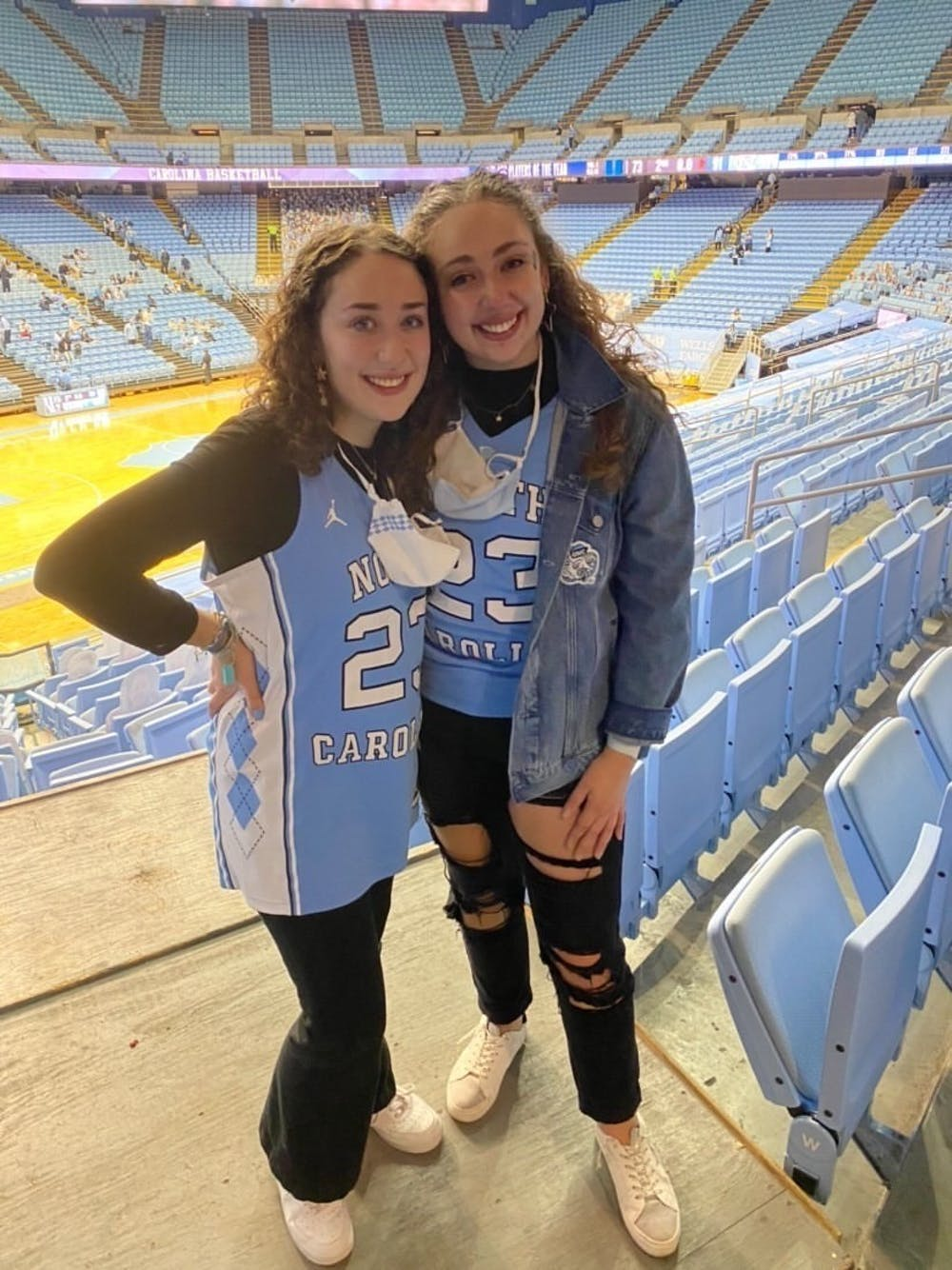 """<p>Senior Katie Weber and First-year Sarah Weber are sisters who have bonded over UNC basketball since going to Carolina. """"It was so exciting to see how energetic he was about the team"""" Sarah said about head Coach Roy Williams.</p>"""