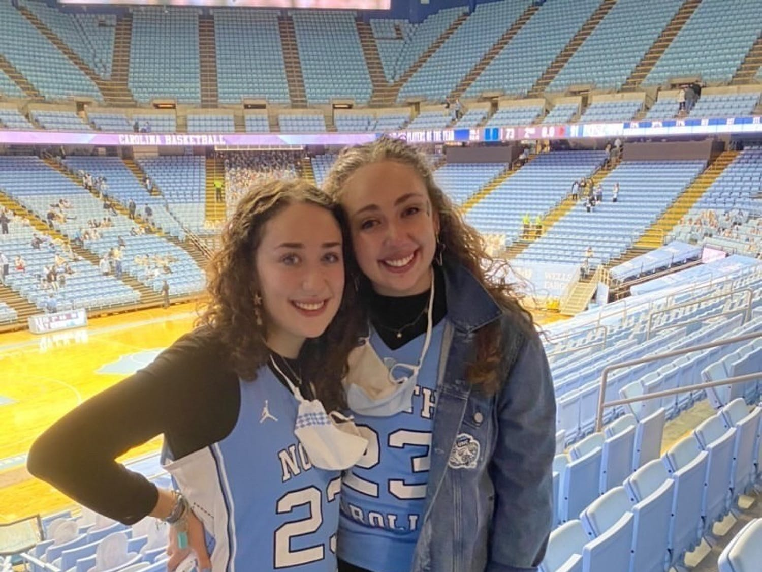 """Senior Katie Weber and First-year Sarah Weber are sisters who have bonded over UNC basketball since going to Carolina. """"It was so exciting to see how energetic he was about the team"""" Sarah said about head Coach Roy Williams."""