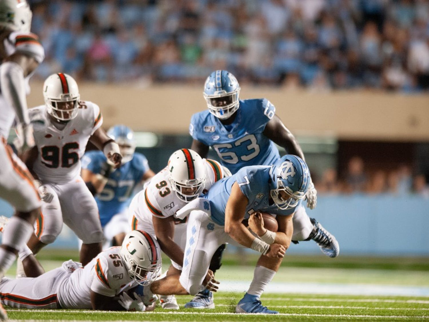 UNC quarterback Sam Howell (7) cradles the ball on Saturday, Sept. 7, 2019 in Kenan Memorial Stadium. UNC beat Miami 28-25.