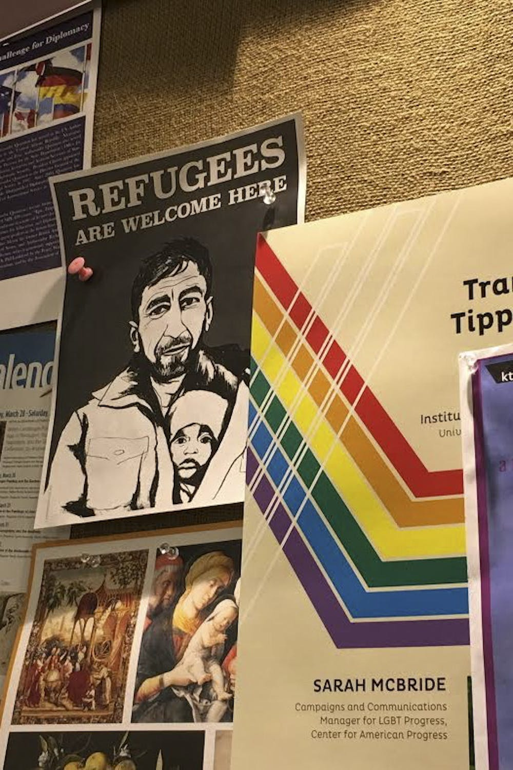 Posters in business windows welcome refugees in Chapel Hill