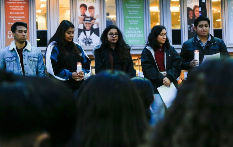 Students and members of the community attended the 'Love Knows No Border' vigil hosted by Mi Pueblo UNC on Thursday, Feb. 14, 2019 in the Pit. The vigil was held to stand in solidarity with students, community members and indivduals across America who have been affected by Immigration and Customs Enfrocement (ICE) raids.