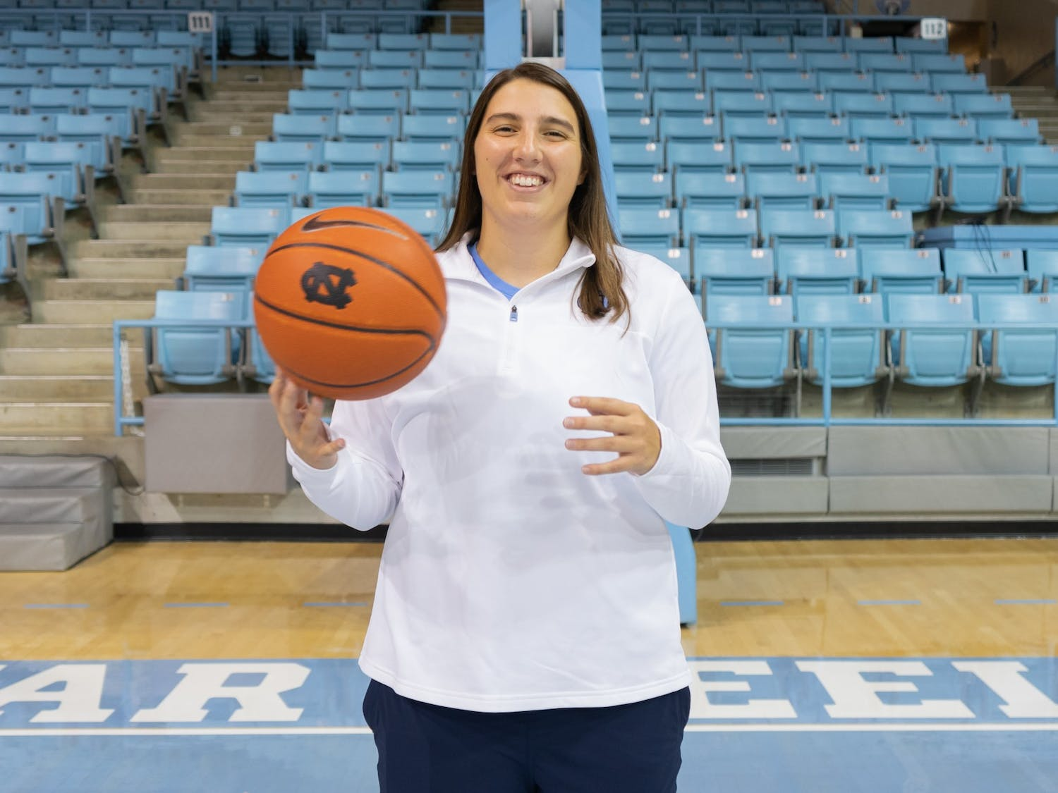Liz Roberts, former UNC Women's Basketball player, poses in Carmichael Arena on Sept. 5. Roberts was recently promoted to Director of Recruiting Management and Student-Athlete Engagement.